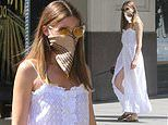 Olivia Palermo looks chic in a white broderie anglaise dress and a silk face covering