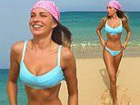 Zara McDermott flaunts her toned physique in a TINY blue bikini in throwback snap