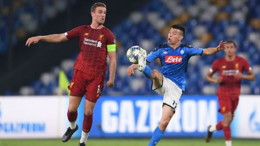 Napoli strikes twice late to defeat Liverpool