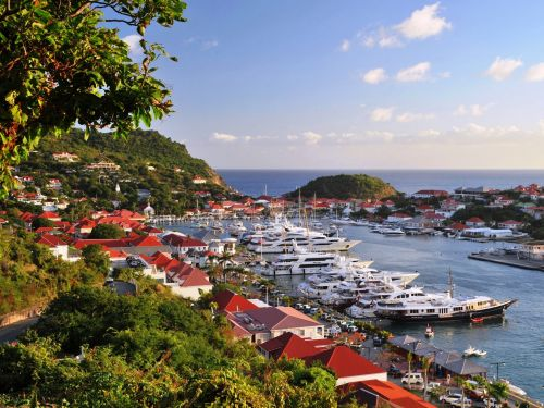 Travelers are flocking to villas on the glitzy Caribbean island of St. Barts for weeks at a time, and it's partially because of how well the island responded to the pandemic