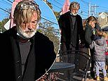 Alec Baldwin is pictured with his family in New England