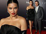 Adriana Lima stuns in LBD with leather gloves while joined by Andre Lemmers at Spencer LA premiere