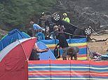 Car skids off 20ft cliff onto beach tent at Newquay just moments after holidaymakers went for paddle