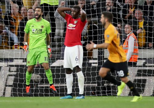 Wolves 1 Man Utd 1: Pogba misses penalty to deny Solskjaer's men victory after Neves screamer