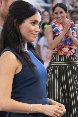 Pregnant Meghan Markle experiments with yet another new hair 'do on royal tour as Duchess of Sussex steps out with chic half-up style