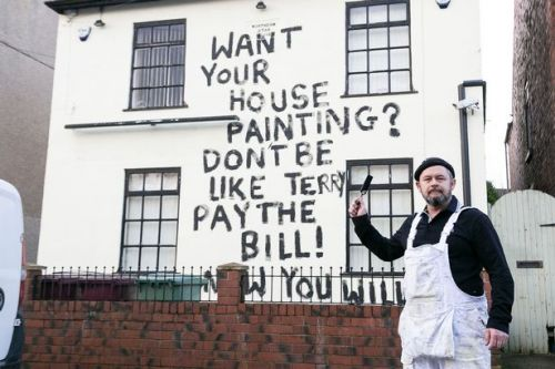 Decorator paints revenge message on wall after customer 'fails to pay bill'