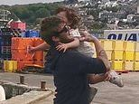 Adorable moment two-year-old girl dashes along quay and leaps into her fisherman father's arms