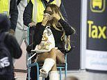Katie Price arrives back in the UK after breaking both her feet in Turkey
