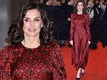 Elegance! Queen Letizia of Spain exudes glamour in a scarlet floral dress with King Felipe VI