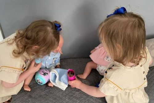 Toddler sisters with 'big, bubbly smiles' in need of 'permanent, loving family'