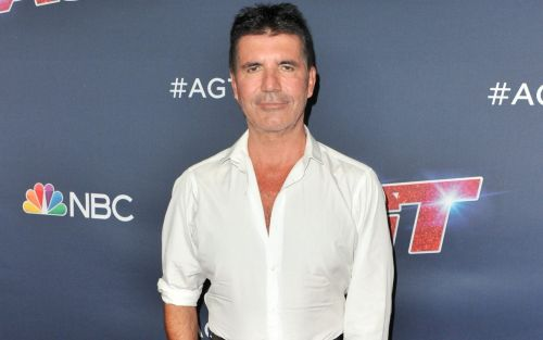 Simon Cowell breaks back after falling off bicycle