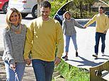 Sarah Jayne Dunn and husband Jonathan Smith put on a loved-up display as they hold hands on walk