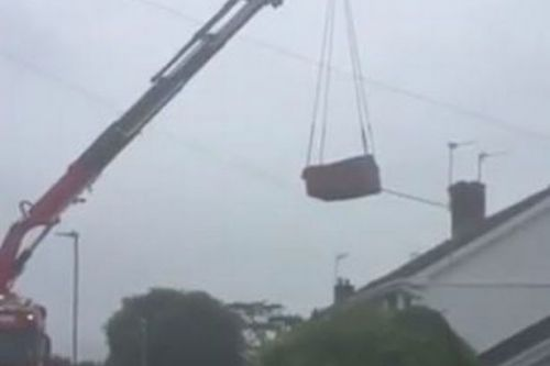 Brand new £5,000 hot tub falls 60ft from crane and crashes into family garden