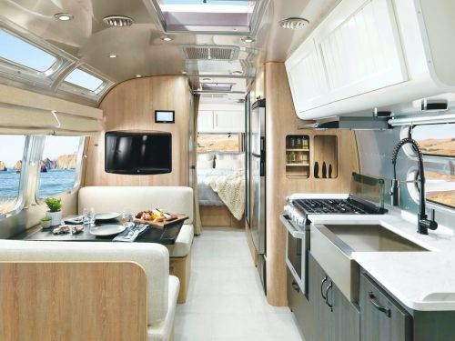 Take a look inside Pottery Barn and Airstream's new luxury $145,500 trailer, which sleeps 5 people and has a solid oak dining table