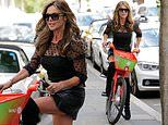 Lizzie Cundy, 53, puts on a leggy display in a black mini skirt and thigh high boots