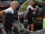 Indiana Jones icon Harrison Ford, 78, gets on his bike during break from filming inNorthumberland