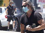 Joaquin Phoenix runs errands in t-shirt and shorts while wearing disposable face mask in LA