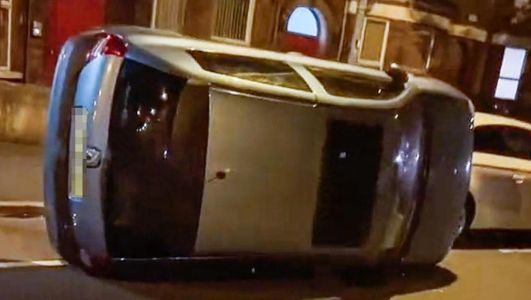 Video circulating of car pushed onto side in Belfast's Holyland, damaging two vehicles