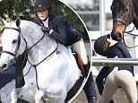 Selma Blair shows off her derriere in tight jodhpurs as she kisses pal's horse on the nose at event