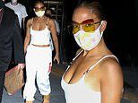 Jennifer Lopez flashes skin in crop top as she heads out wearing protective glasses and face mask