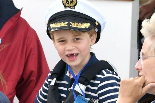 Prince George looks like dad William's 'Mini-Me' in heartwarming photographs