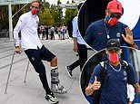 Thomas Tuchel makes his way to PSG's training camp on crutches while sporting a protective boot
