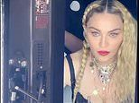 Madonna poses in black lace lingerie as she declares 'today is the day'