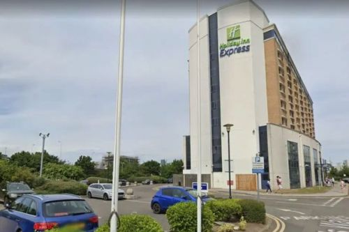 Woman stabbed to death at Holiday Inn hotel before man 'falls from height'