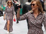 Amanda Holden shows off her tanned legs in a leopard print maxi dress with thigh-high slit