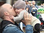 Aaron Paul dotes on baby daughter Story as he hugs and kisses her on trip to Farmer's Market in LA
