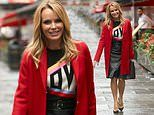 Amanda Holden puts on a leggy display in a bright red coat as she leaves Heart Radio