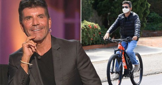 Simon Cowell 'recovering from 5-hour surgery' after 'breaking his back' in bike accident