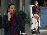 Pregnant Christine Lampard engages in a phone call during stroll with daughter Patricia, 2