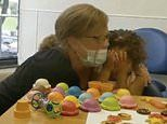 Heartwarming moment Kansas girl, 2, hears for the first time following cochlear implant surgery