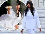 Jameela Jamil styles a white suit with comfy trainers as she poses for a photoshoot in LA