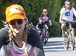 Kate Hudson sports orange baseball cap and pigtails for bicycle ride with son and boyfriend in LA