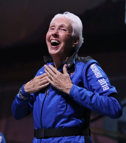 A Virgin Galactic ticket holder who met Blue Origin passenger Wally Funk at parties said the 82-year-old had 'the energy of 6,000 labradors'