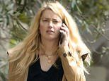 Amber Heard loses bid to get $50 million defamation suit by her ex Johnny Depp thrown out as he