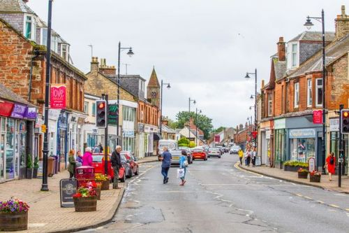 Man charged in connection with robbery at Scots shop