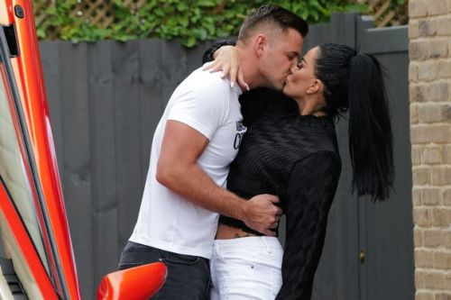 Katie Price snogs Love Island's Carl Woods as pair confirm new romance