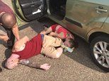 Sweating baby is rescued from a hot car after parents overdosed