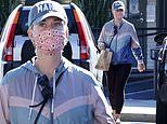 Katy Perry picks up some take out food in tracksuit top and legging in Santa Barbara