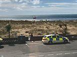 Man dies after three children 'got caught in a rip tide' in the sea on Welsh coast