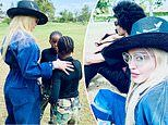 Madonna is a fashionable spectator at her son David's soccer match withdaughters and boyfriend