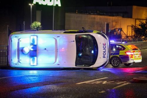 Two officers taken to hospital after police van on 999 call crashes with BMW