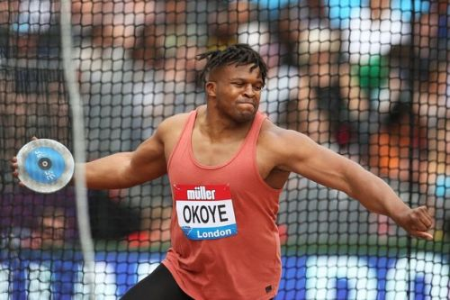 Lawrence Okoye set to stay with athletics after 60m throw on return from NFL