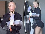 Instagram sensation Tammy Hembrow shows off her famous derriere in a pair of TINY booty shorts