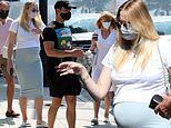 Sophie Turner covers her baby bump on a breakfast date with her husband Joe Jonas and her parents