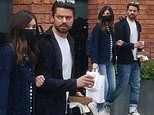 Dominic Cooper cuts a casual figure in a cardigan as he grabs food with girlfriend Gemma Chan