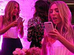 Nadia Bartel looks animated as she reads off her phone at the Lana Wilkinson shoe launch